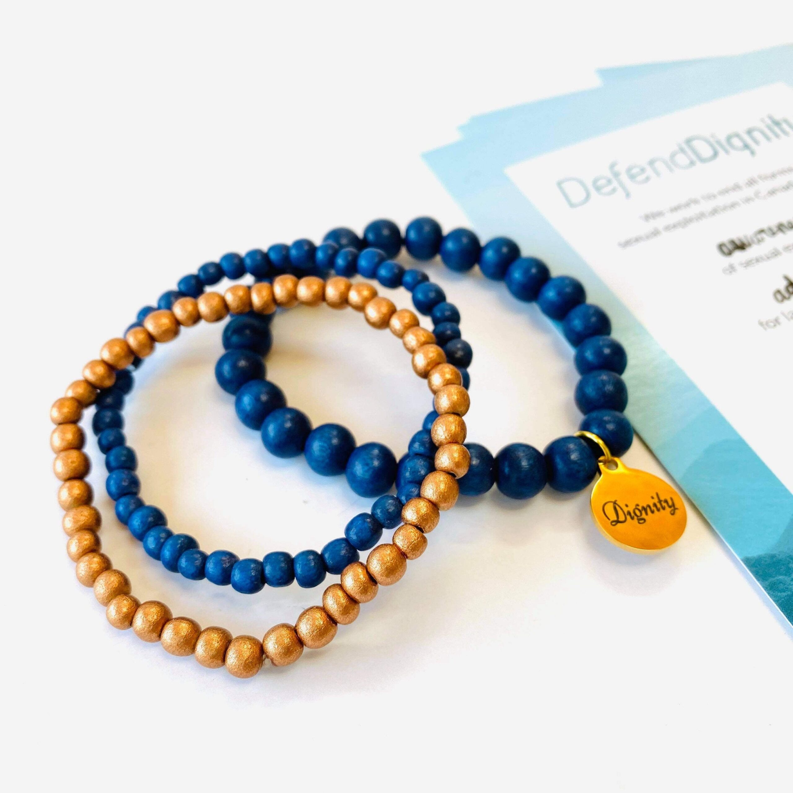 https://www.redeemedwithpurpose.com/listing/867645950/defend-dignity-bracelets-navy-copper